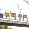 Banner Over I-80 with Our Messages to the World, Aug 19